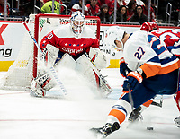 WASHINGTON, DC - JANUARY 31: Braden Holtby #70 of the Washington Capitals  watches the action in front of his goal during a game between New York Islanders and Washington Capitals at Capital One Arena on January 31, 2020 in Washington, DC.