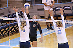 10 September 2015: Stanford's Sidney Brown (11) hits towards North Carolina's Leigh Andrew (4) and Paige Neuenfeldt (5). The University of North Carolina Tar Heels hosted the Stanford University Cardinal at Carmichael Arena in Chapel Hill, NC in a 2015 NCAA Division I Women's Volleyball contest. North Carolina won the match 25-17, 27-25, 25-22.