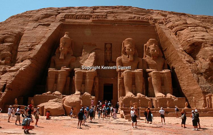 Fascade of Temple, Abu Simbel, Egypt, Colossal figures of Ramses II wearing double crown, New Kingdom