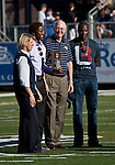 October 6, 2012:   Left to right:  Cary Groth, Nevada Director of Athletics, Nate Burleson, Detroit Lions receiver, Marc Johnson, University of Nevada President and Nate's father during the first quarter of Nevada Wolf Pack vs Wyoming Cowboys football game played at Mackay Stadium on Saturday afternoon in Reno, Nevada.  Nate Burleson received his Nevada Hall of Fame plaque.