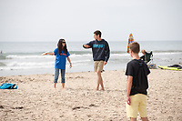 Incoming first-years participate in Oxy Engage with a visit to Rincon Surf Beach on Aug. 19, 2014, one of the stops made by the California Coast group.<br />