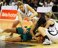 NZ's Lisa Wallbutton and Toni Edmondson (right) try to get the ball off Eva Afeaki during the International women's basketball match between NZ Tall Ferns and Australian Opals at Te Rauparaha Stadium, Porirua, Wellington, New Zealand on Monday 31 August 2009. Photo: Dave Lintott / lintottphoto.co.nz
