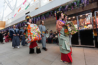 Actors dressed as geisha and samurai from the Edo (samurai) Period to welcome visitors to Haneda International Airport, Tokyo, Japan. Tuesday May 3rd 2016. The Edo festival takes place over the three days of national holidays called Golden Week ( May 3rd to 5th) and features costume parades, music and stage shows along with other fun activities for visitors in and around the Edo themed shopping areas in the terminal building.