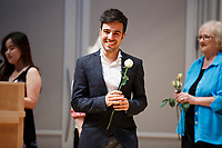 Contestant Valerio Lisci of Italy reacts after being greeted on stage with a rose during the opening ceremony of the 11th USA International Harp Competition at Indiana University in Bloomington, Indiana on Wednesday, July 3, 2019. (Photo by James Brosher)