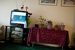 December 16, 2010. Raleigh, NC.. A country music channel plays on the TV in TP Mishra's apartment.. TP Mishra, a refugee from Bhutan, has recently relocated from the Bronx to Raleigh, where he lives in an suburban apartment  with his wife, as well as another Bhutanese couple.