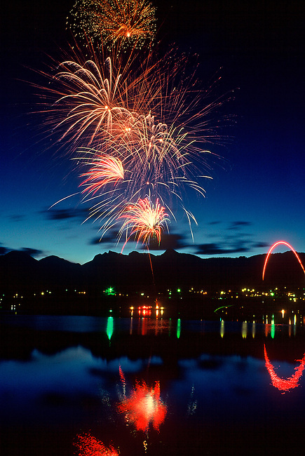 Fireworks fill the sky over Lake Estes during the 4th of July celebration in Estes Park, Colorado Rocky Mountains, USA