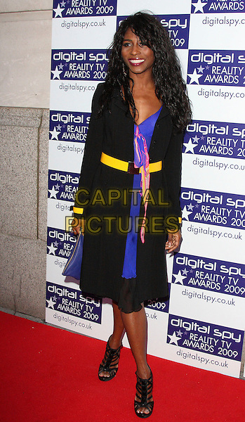 SINITTA (Sinitta Renet Malone) .Digital Spy Reality TV Awards at the Bloomsbury Ballroom, London, England.  .April 6th, 2009.full length strappy sandals black jacket yellow belt purple dress .CAP/ROS.©Steve Ross/Capital Pictures.