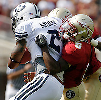 TALLAHASSEE, FL 9/18/10-FSU-BYU FB10 CH-Florida State's Greg Reid wraps up Brigham Young's Cody Hoffman during first half action Saturday at Doak Campbell Stadium in Tallahassee. .COLIN HACKLEY PHOTO