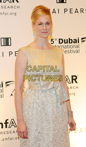 LAURA LINNEY.Hotel Atlantis, The Palm.The 2nd Annual amfAR Cinema Against AIDS, Dubai during the 5th Annual Dubai International Film Festival,.United Arab Emirates December 13th, 2008.half length silver white cream sleeveless embroidered pattern dress bow ribbon sash waist .CAP/RD.©Richard Dean/Capital Pictures