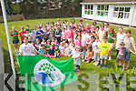 Scoil Mhichi?l Naofa Du?n Ge?again raised their second Green Flag for water conservation on Friday last pictured here front l-r: Felix Schmid the oldest pupil and Ella Murphy the youngest who had the honor of raising the flag.