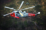 Royal Navy Search and Rescue Sea King Helicopter from HMS Gannet, Prestwick,  flies through Glencoe, Scotland. <br /> HMS Gannet is the busiest SAR station in UK<br /> Peter Sandground&copy;2014