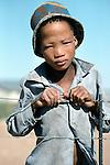 San Bushmam boy,  Tchumkwe, Bushman land, Namibia