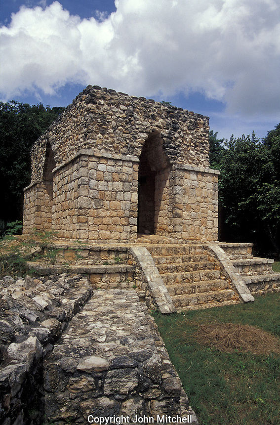 Structure 18 at the entrance to the Mayan ruins of Ek' Balam, Yucatan, Mexico. This unusual building with four corbeled arches may have a guardhouse.