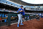 OMAHA, NE - JUNE 26: University of Florida head coach Kevin O'Sullivan enjoys a moment with his son before his team takes on Louisiana State University during the Division I Men's Baseball Championship held at TD Ameritrade Park on June 26, 2017 in Omaha, Nebraska. The University of Florida defeated Louisiana State University 4-3 in game one of the best of three series. (Photo by Jamie Schwaberow/NCAA Photos via Getty Images)