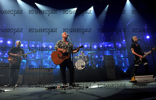 PIXIES - L-R: Joey Santiago, Black Francis, David Lovering, Kim Shattuck - performing live on Day 25 of the iTunes Festival at The Roundhouse in London UK - 25 Sep 2013.  Photo credit: George Chin/IconicPix