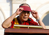 Washington, DC - October 17, 2007 -- The 14th Dalai Lama, Tenzin Gyatso, adjusts his visor that protects his eyes from the sun's glare as he makes a speech on the West Lawn of the United States Capitol in Washington, D.C. on Wednesday, October 17, 2007.  Earlier, inside the Rotunda of The Capitol the Dalai Lama accepted the Congressional Gold Medal, the nation's highest and most distinguished civilian award..Credit: Ron Sachs/CNP
