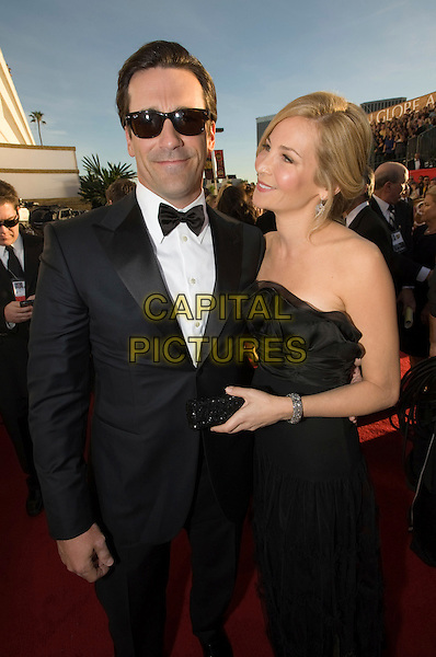 JON HAMM & JENNIFER WESTFELDT.Arrivals at the 66th Annual Golden Globe Awards held at the Beverly Hilton Hotel, Beverly Hills, California, USA..January 11th, 2009.*Editorial Use Only* .globes full length 3/4 black layers layered ruffled ruffles dress long strapless sheer clutch bag couple tuxedo jacket sunglasses shades .CAP/AWF/HFPA .Supplied by Capital Pictures.