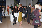 Guests attend the Ann Taylor Spring Summer 2017 fashion presentation by Austyn Zung, at the Ann Taylor showroom in 7 Times Square, New York on October 26, 2016.