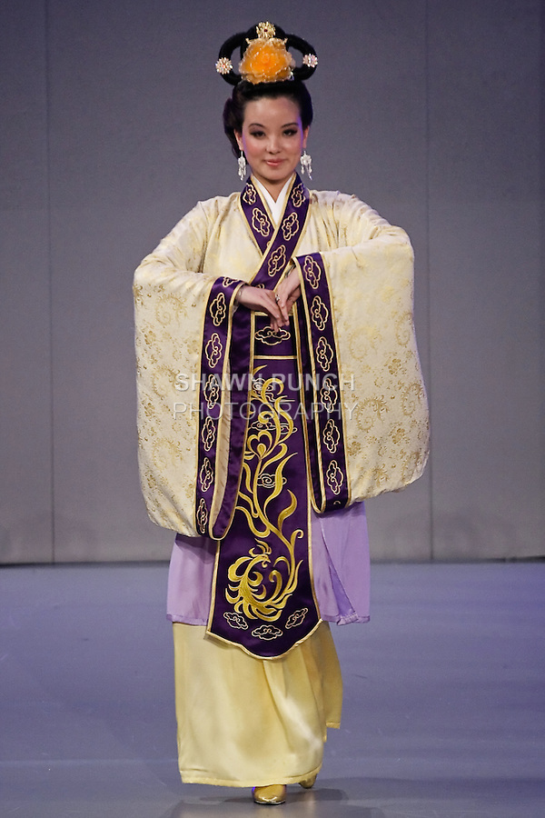 Model walks the runway in a traditional Chinese outfit, from the Global Han Couture Design Comptition, during Couture Fashion Week Spring 2012.