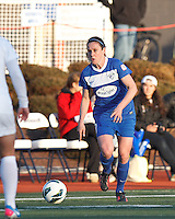 Boston Breakers midfielder Heather O'Reilly (9) works to clear ball. In a National Women's Soccer League Elite (NWSL) match, the Boston Breakers (blue) tied the Washington Spirit (white), 1-1, at Dilboy Stadium on April 14, 2012.