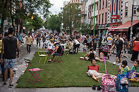 """Bedford Avenue is closed for """"Williamsburg Walks: Rethink Your Public Space"""" in the trendy hipster Williamsburg neighborhood of Brooklyn in New York on Saturday, June 8, 2013. The Dept. of Transportation closes several blocks in various neighborhoods for street activity where tables and chairs (and grass lawns) are set out and merchants vend their wares on the streets. © Richard B. Levine)"""