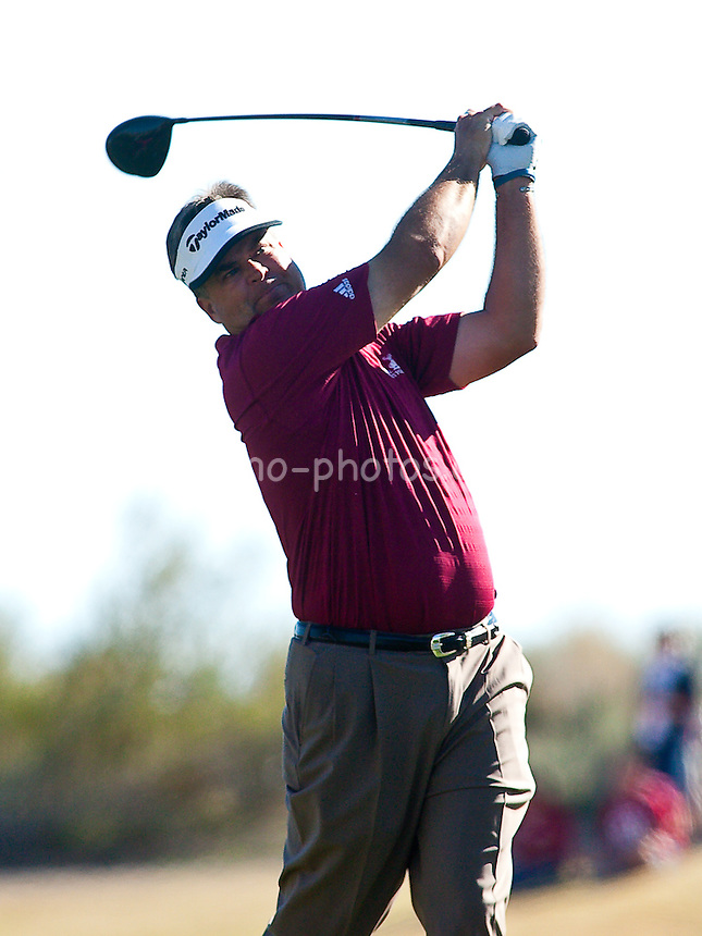 Feb 1, 2009; Scottsdale, AZ, USA; Kenny Perry hits his tee shot on the 13th hole during the final round of the FBR Open at the TPC Scottsdale.  Perry would win the tournament in a playoff against Charley Hoffman (USA, not pictured) Mandatory Credit: Chris Morrison-US PRESSWIRE