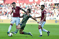 27th October 2019; Olympic Grande Torino Stadium, Turin, Piedmont, Italy; Serie A Football, Torino versus Cagliari; Luca Pellegrini of Cagliari challenges Daniele Baselli of Torino FC - Editorial Use