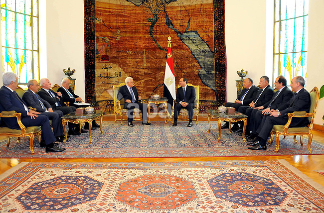 A handout picture released by the Egyptian Presidency on March 20, 2017 shows Egyptian President Abdel Fattah al-Sisi (R) meeting with Palestinian president Mahmud Abbas at the presidential palace in Cairo. Photo by Egyptian President Office