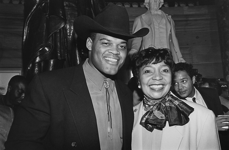 Football coach Ken Norton and Rep. Eddie Bernice Johnson, D-Tex., at the Dallas Cowboys/Texas Delegation Reception in National Statuary Hall on March 08, 1993. (Photo by Laura Patterson/CQ Roll Call via Getty Images)