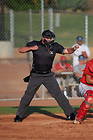 Home plate umpire Luke Morris calls a batter out on strikes during a game between the AZL Angels and AZL Giants Orange at Giants Baseball Complex on June 17, 2019 in Scottsdale, Arizona. AZL Giants Orange defeated AZL Angels 8-4. (Zachary Lucy/Four Seam Images)