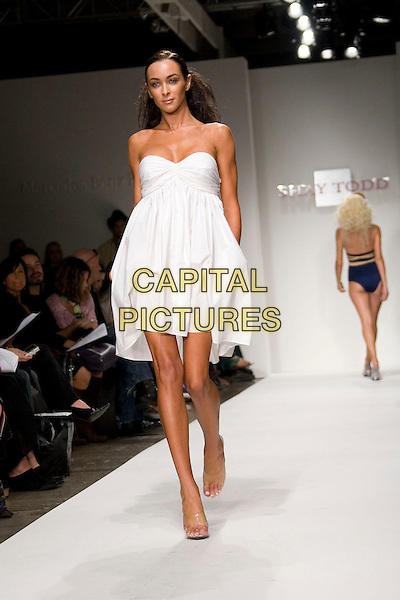MODEL.Mercedes-Benz Spring 2007 L.A. Fashion Week - Shay Todd - Runway held at Smashbox Studios, Culver City, California, USA..October 16th, 2006.Ref: ADM/ZL.catwalk modelling full length white strapless dress.www.capitalpictures.com.sales@capitalpictures.com.©Zach Lipp/AdMedia/Capital Pictures.
