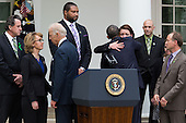 United States President Barack Obama hugs Nicole Hockley after delivering a statement after gun legislation failed in Congress, in the Rose Garden at the White House, in Washington, Wednesday, April 17, 2013. The president was accompanied by U.S. Vice President Joe Biden, former U.S. Representative Gabby Giffords (Democrat of Arizona), seen at left, and family members from Newtown..Credit: Drew Angerer / Pool via CNP