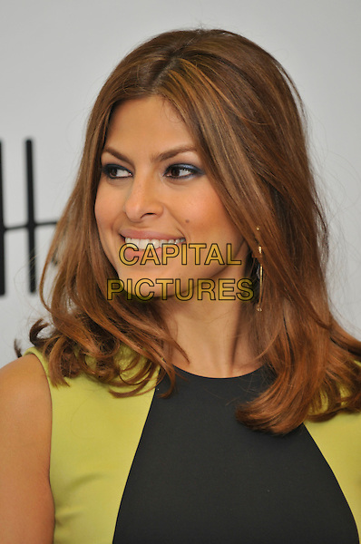 EVA MENDES.Calvin Klein Underwear's Seductive Comfort line photocall , at Harrods.  Eva Mendes currently features in Calvin Klein Underwear autumn 2008 advertising campaign. .Knighsbridge, London, England.14th October 2008 .portrait headshot black green earrings .CAP/PL.©Phil Loftus/Capital Pictures