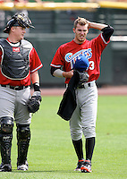 Norfolk Tides Starting Pitcher Brandon Erbe (33) walks to the dugout with catcher Adam Donachie during a game vs. the Rochester Red Wings at Frontier Field in Rochester, New York;  June 3, 2010.   Rochester defeated Norfolk by the score of 9-0.  Photo By Mike Janes/Four Seam Images