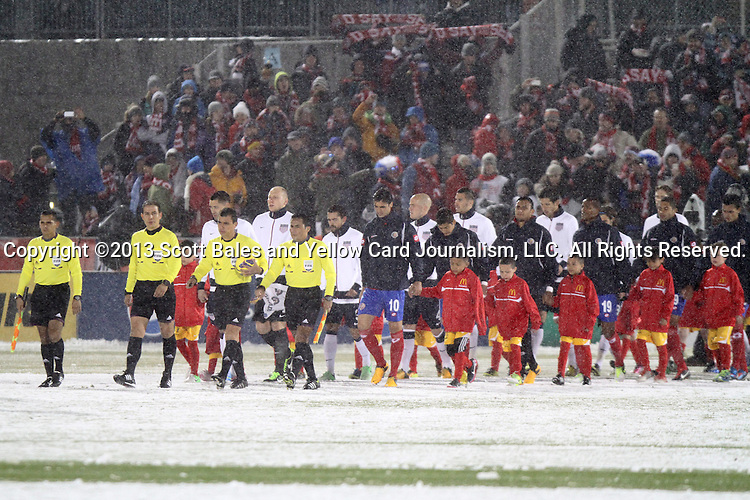 22 March 2013: The referees and starters march onto the snow covered field for the game. The United States Men's National Team played the Costa Rica Men's National Team at Dick's Sporting Goods Park in Commerce City, Colorado in a CONCACAF World Cup Qualifying Final Round match for the 2014 FIFA World Cup. The United States won the game 1-0.
