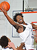 Aidan Igiehon #22 of Lawrence Woodmere Academy leaps to get a rebound during a varsity boys basketball game against Berkeley Carroll (Brooklyn) at Lawrence Woodmere Academy on Friday, Dec. 9, 2016. LWA won 92-39.