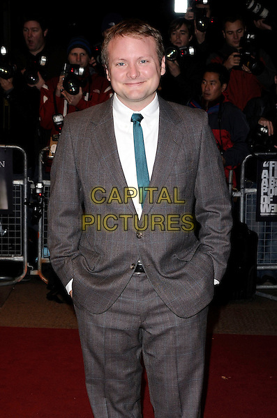"RIAN JOHNSON, director .At ""The Brothers Bloom"" UK Premiere during the London Film Festival, Odeon West end, London, England, .October 27th 2008..half length green tie grey gray brown plaid suit .CAP/CAN.©Can Nguyen/Capital Pictures"