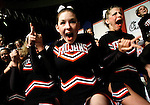 Trinity High School cheerleaders Megan Saddler, left, and Holly Martin react after their score was announced during the final round of the NCA National Championship at Dallas Convention Center on Wednesday December 29, 1999.  Trinity placed in the top 10 over all in the large varsity division.  (photo by Khampha Bouaphanh)