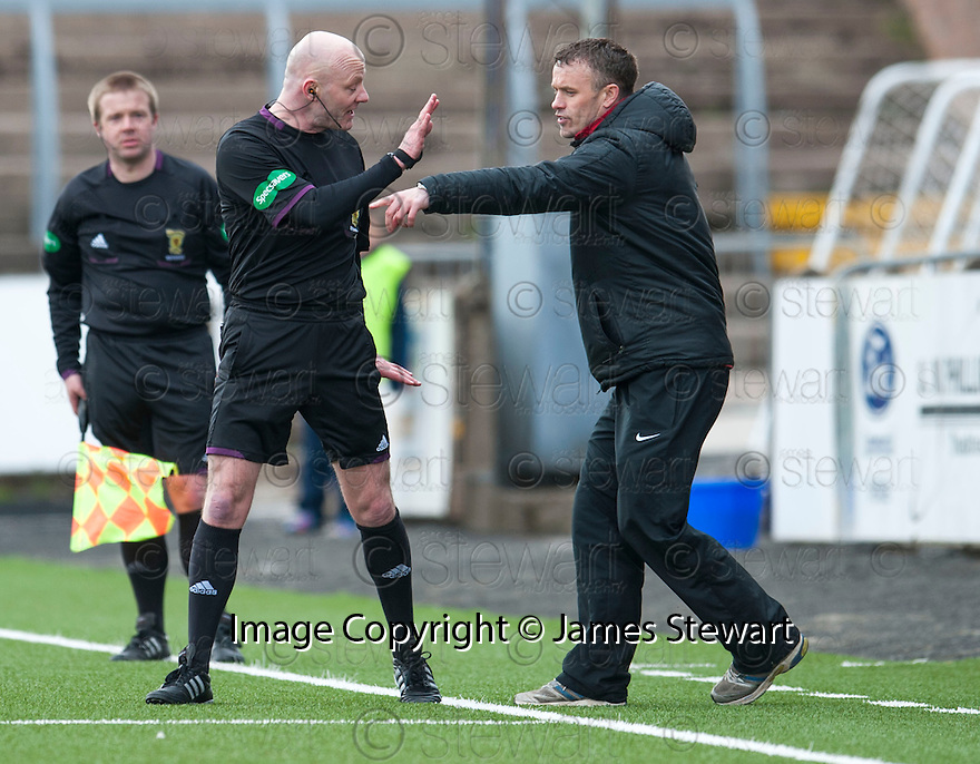 Referee Craig Charleston has a word with Ayr Utd Manager Mark Roberts after awarding Forfar a penalty.