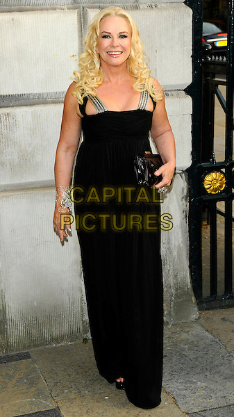 DR. PAMELA STEPHENSON.Women For Women - gala and awards ceremony, Banqueting House, Whitehall, London, England..May 5th, 2011.full length maxi dress black clutch bag.CAP/CJ.©Chris Joseph/Capital Pictures.