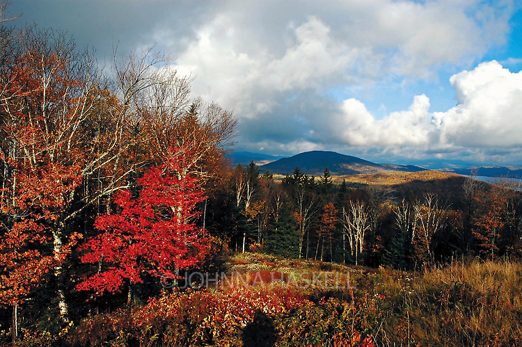 Bald Mountain as seen from the overlook of Rangeley Lake showing vibrant fall colors after a storm.