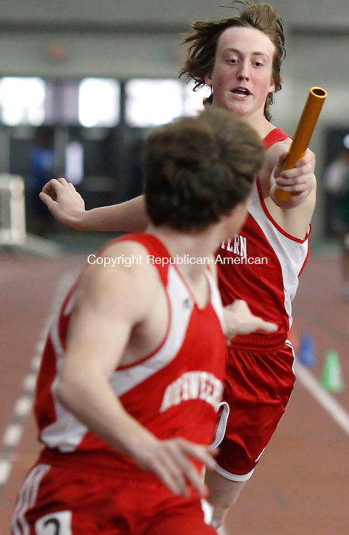 New Haven, CT-06 February 2012-021012CM04-   Northwestern's Adam Pezczolkowski hands off the baton to anchor, Eddie Eseppi  during the boy's 4x200m event during the Class S Track and Field Championships at the New Haven Athletic center Friday night in New Haven.  Also in the their relay was  Phillips Garcia hands and Eric Parady. Christopher Massa Republican-American