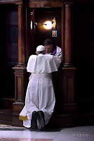 Pope Francis' receives confession during the penitential celebration in St. Peter's Basilica at the Vatican, March 17, 2017.