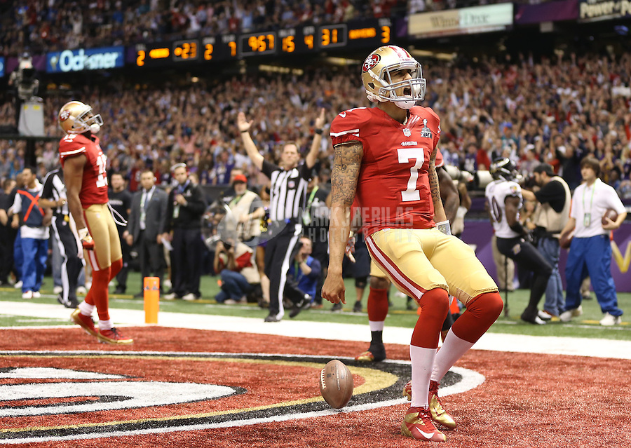 Feb 3, 2013; New Orleans, LA, USA; San Francisco 49ers quarterback Colin Kaepernick (7) celebrates after scoring a touchdown against the Baltimore Ravens in the fourth quarter in Super Bowl XLVII at the Mercedes-Benz Superdome. Mandatory Credit: Mark J. Rebilas-