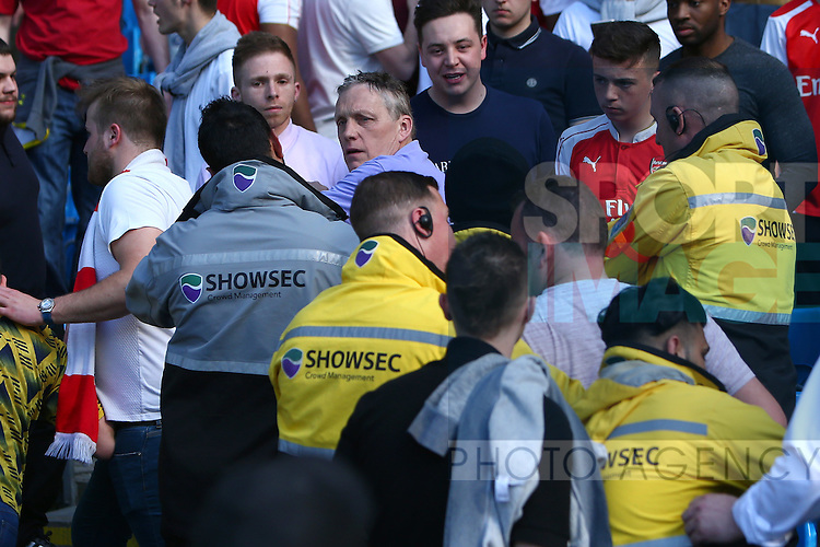 Fights break out amongst the Arsenal fans over their support of manager Arsene Wenger during the Barclays Premier League match at the Etihad Stadium. Photo credit should read: Philip Oldham/Sportimage