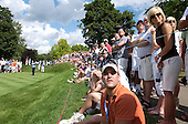 Opening round: Golf fans watch the ball head toward the ninth hole during the opening round of the PGA Championship at Oakland Hills Country Club Thursday.