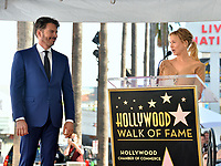 LOS ANGELES, CA. October 24, 2019: Harry Connick Jr. & Renee Zellweger  at the Hollywood Walk of Fame Star Ceremony honoring Harry Connick Jr.<br /> Pictures: Paul Smith/Featureflash