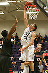 SIOUX FALLS, SD - JANUARY 16:  Bryan Kielpinski #52 from the University of Sioux Falls slams home two points past Urbane Bingham #35 and Matt Nelson #13 from Minnesota Moorhead in the first half of their game Friday night at the Stewart Center.  (Photo by Dave Eggen/Inertia)