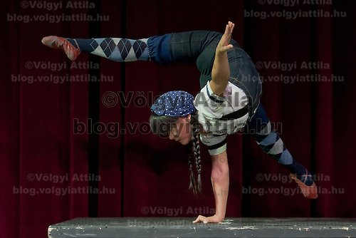 Contortionist Gana Ganchimeg member of the Cirque Mechanics company performs during a press conference of their show Bird House Factory they present in Budapest, Hungary on April 28, 2011. ATTILA VOLGYI