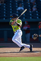 Hayden Senger (15) of the Columbia Fireflies follows through on his swing against the Rome Braves at Segra Park on May 13, 2019 in Columbia, South Carolina. The Fireflies walked-off the Braves 2-1 in game one of a doubleheader. (Brian Westerholt/Four Seam Images)